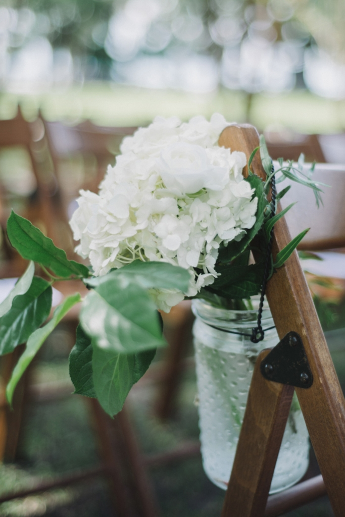 Florals by Tiger Lily Weddings. Wedding design and coordination by Lindsey Shanks of A Charleston Bride. Photograph by Sean Money + Elizabeth Fay at Lowndes Grove Plantation.