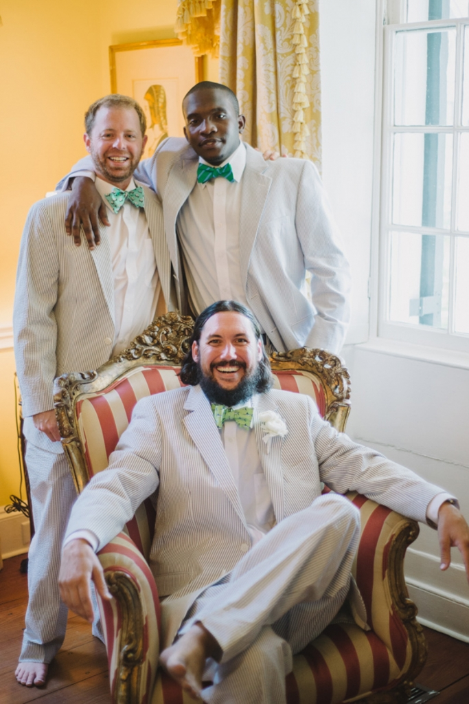 Groom and groomsmen's suits by Hardwicks. Bow ties by Southern Proper and Bird Dog Bay. Photograph by Sean Money + Elizabeth Fay at Lowndes Grove Plantation.