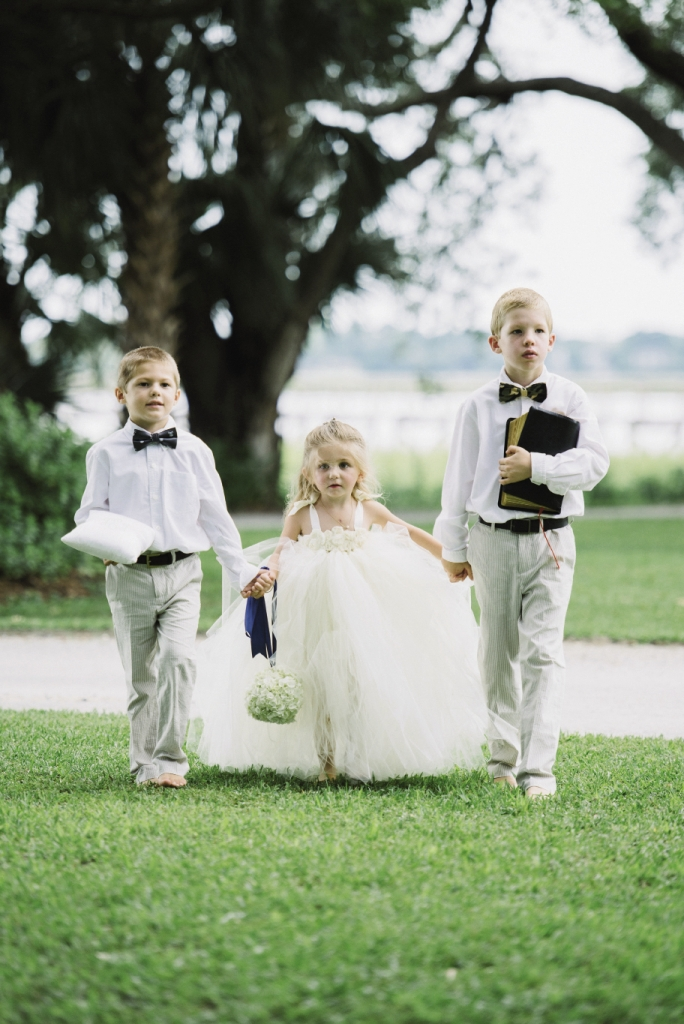 WEET TRIO: Flower girl Ann Hobson, Julie's  goddaughter, wore a dress by Tutully Cute Designs from Etsy. Julie's nephew Landon Daubenspeck served as ring bearer, while his older brother Noah carried Julie's late grandmother's Bible.