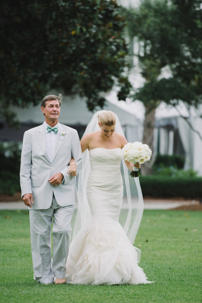 Bride's gown by Vera Wang. Father of the bride's suit by Hardwicks. Floral by Tiger Lily Weddings. Photograph by Sean Money + Elizabeth Fay at Lowndes Grove Plantation.