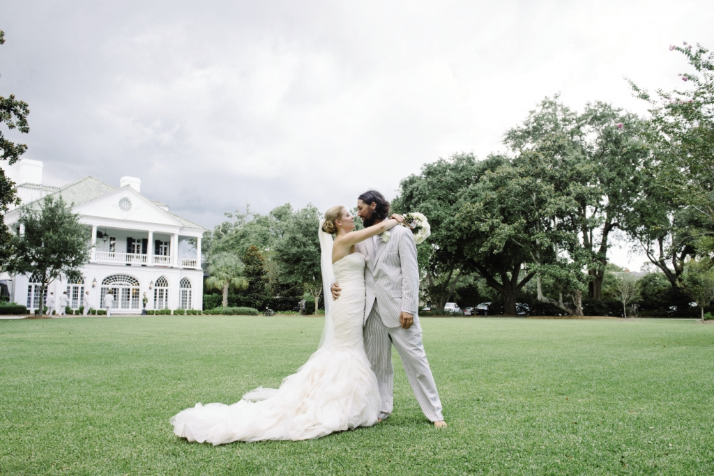 THE MODERN SOUTH: Julie donned a Vera Wang gown  with a flowing skirt while Lee chose gray seersucker.