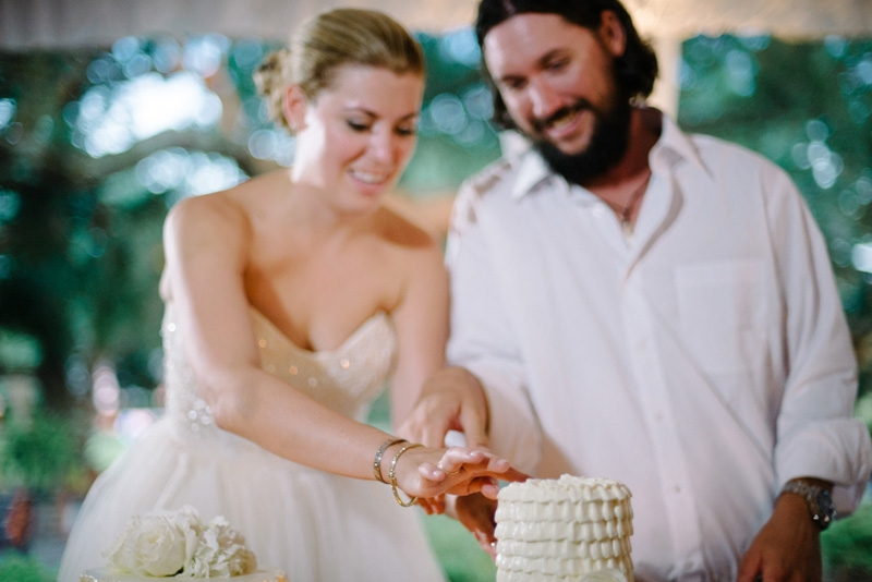 Wedding cakes by Fish Restaurant. Bride's dress by Reem Acra. Wedding design and coordination by Lindsey Shanks of A Charleston Bride. Photograph by Sean Money + Elizabeth Fay at Lowndes Grove Plantation.
