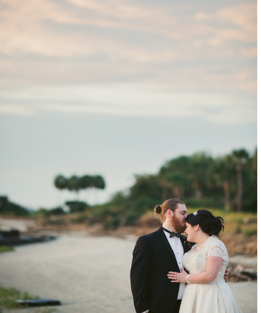 "Victoria chose their Halloween wedding date not for the holiday, but for its proximity to the month's full moon. ""The tide pulls back enough to give you a tiny private beach [at my parents' house], which makes for great photos,"" she says.  (Image by Juliet Elizabeth Photography)"