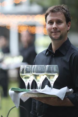 """SERVING IT UP: Cru Catering delighted those unfamiliar with Lowcountry fare. Says Kiften, """"Many of our guests were out-of-state, and they were definitely loving the southern cuisine."""""""