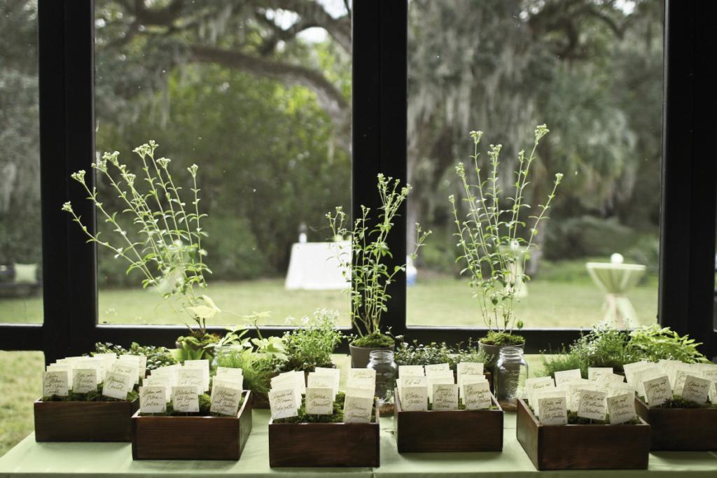 BRIGHT IDEA: To spice up the table assignments, Hannah Alexander potted them among greenery in dark-stained wooden boxes.