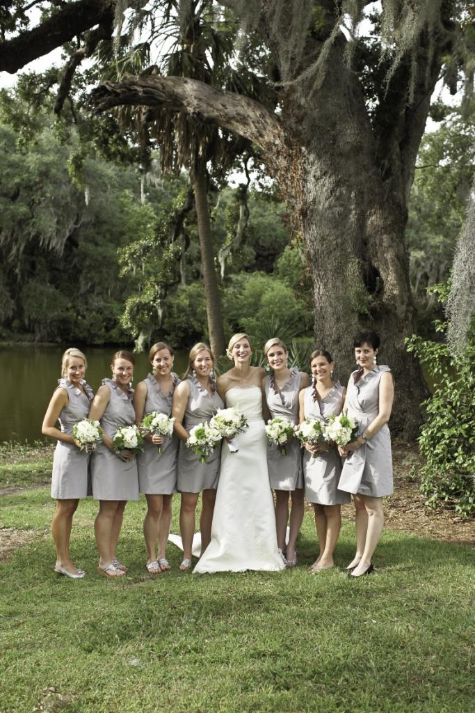 DRESS TO IMPRESS: The soft driftwood hue of the bridesmaids' J.Crew frocks complemented both the bride's custom gown and the majestic surroundings.