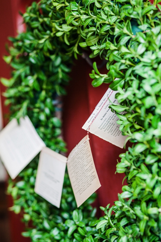 BANNER TIME: An evergreen wreath, strung with a garland sewn with vintage book flags, welcomed guests.