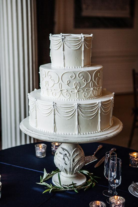 PIPED PERFECTION: Jim Smeal of Wedding Cakes by Jim Smeal created a white three-tiered wedding cake.