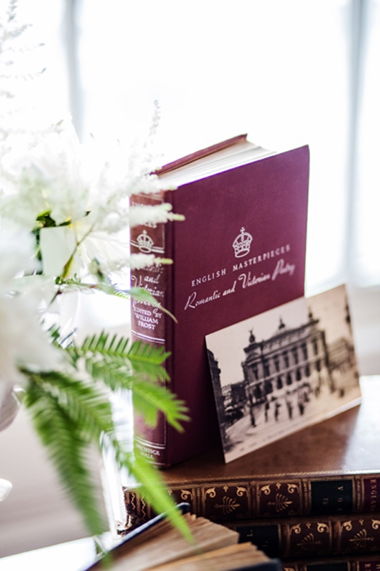 LANDMARK DETAILS: Vintage postcards of Paris featured on the guest book table.