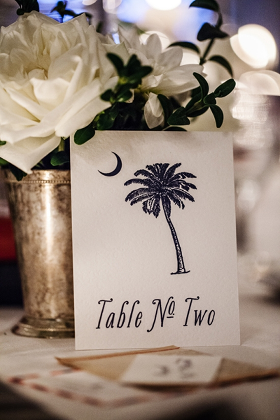 SOUTHERN SMILE: ….While the Holy City's signature Palmetto (here, next to a julep cup-turned-bud-vase) was a reminder of the bride's South Carolina roots.