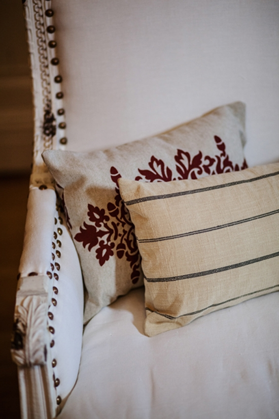FRENCH COUNTRY: To add a hint of vintage, textured pillows were tossed onto pristine white couches.