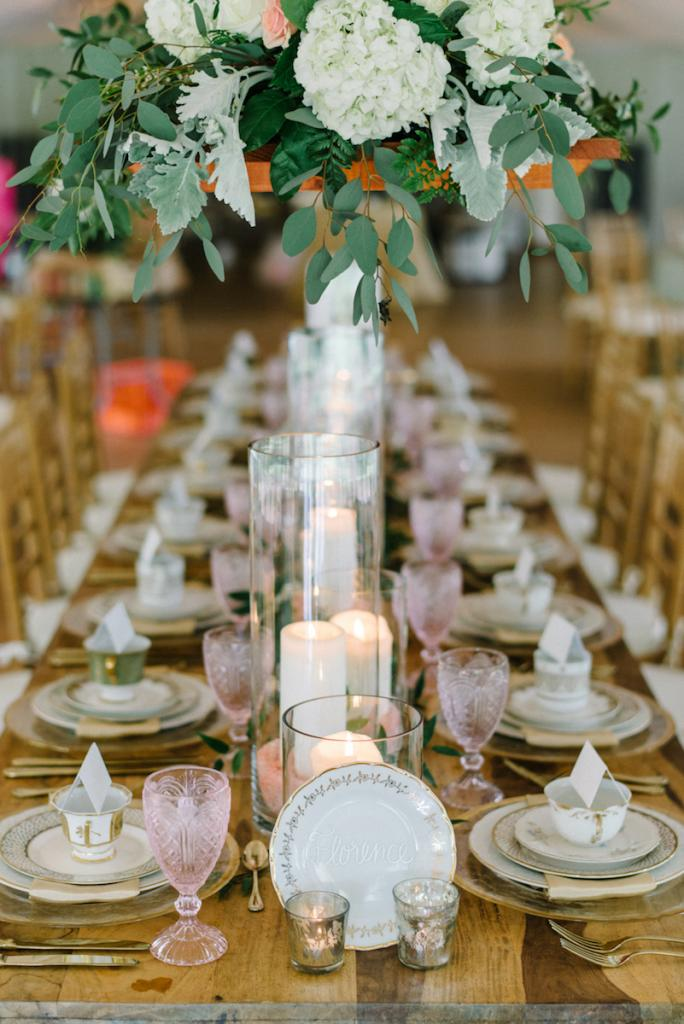 Photograph by Sean Money + Elizabeth Fay. Florals by A Charleston Bride. Tableware by Polished!. Signage by Sarah Drake Design.