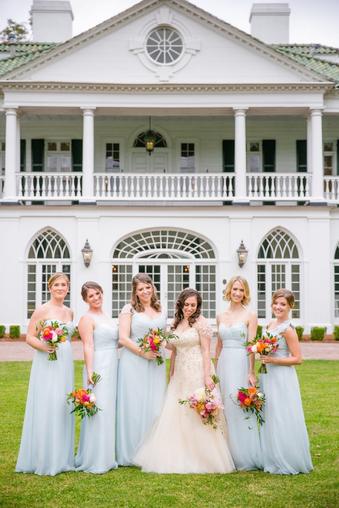 Bride's gown by Monique Lhuillier, available in Charleston through Maddison Row. Florals by Branch Design Studio. Bridesmaid gowns by Amsale from Bella Bridesmaids. Image by Dana Cubbage Weddings at Lowndes Grove Plantation.