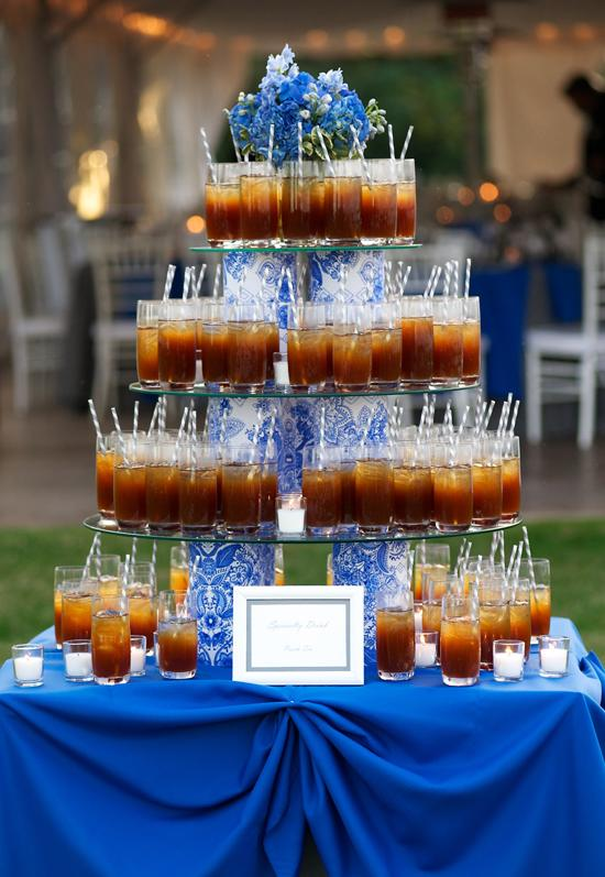 "CHEERS: The tiered beverage display featured the ""sea oats"" motif and was topped with fresh flora."