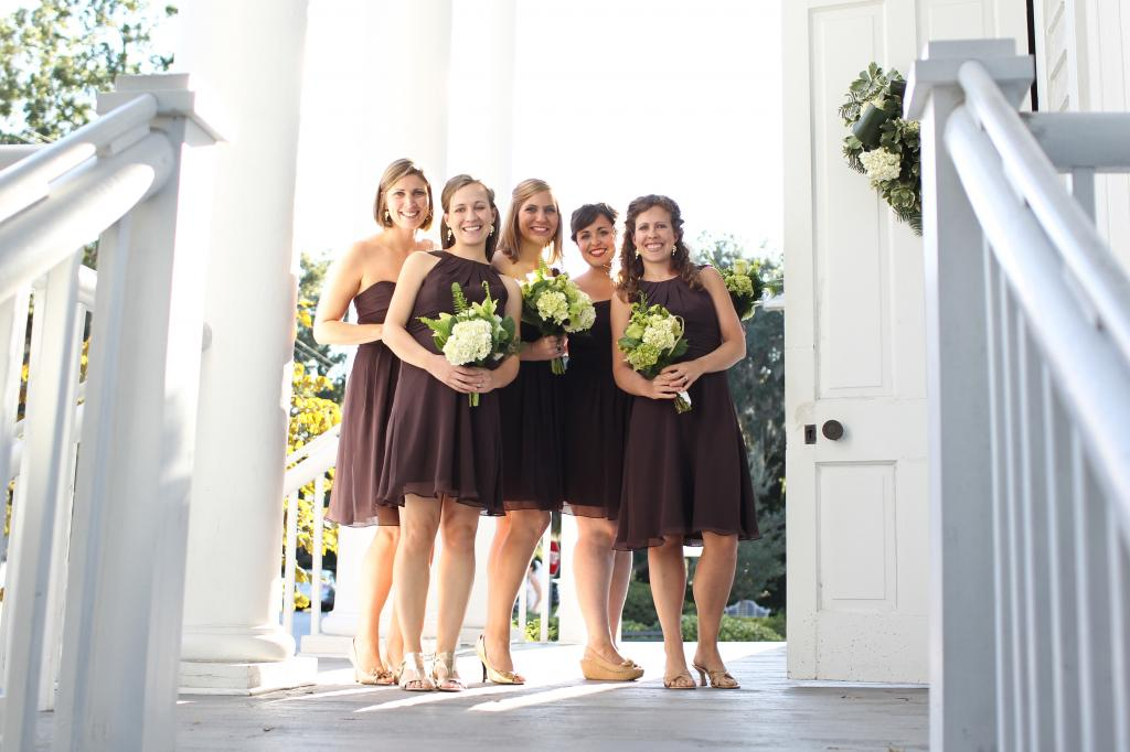 MIX AND MATCH: The chocolate brown bridesmaids' dresses all fell just above the knee—their cut, however, varied from maid to maid.