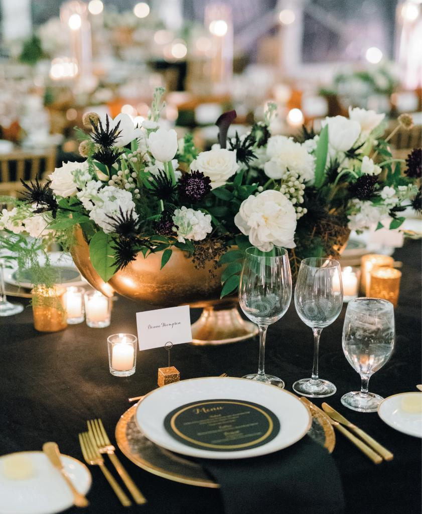 Given that the bride's family loves black and white everything, given the groom's a fan of the Saints, and given that New Year's Eve pretty much equals black, white and gold, Alexa went with that formal color scheme to dress the couple's Big Day.