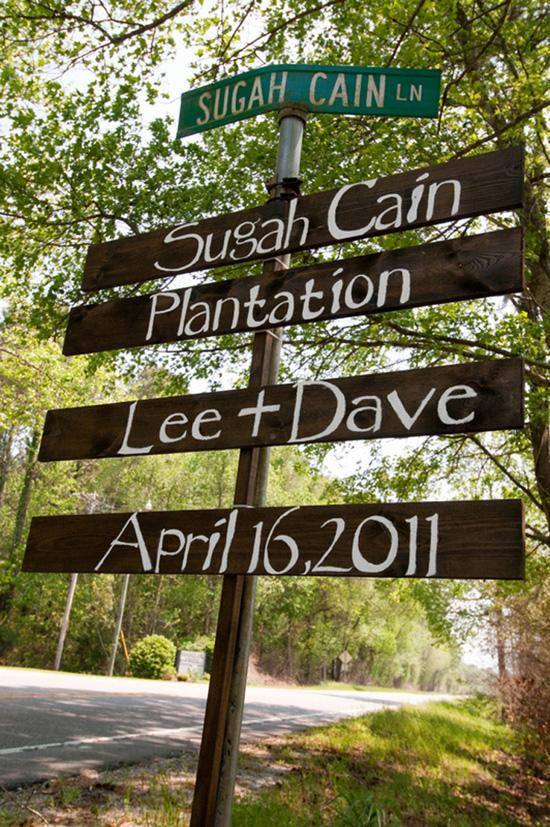 DIY DIRECTIONS: Wooden signs painted by Duvall hinted at the day's down-to-earth vibe.