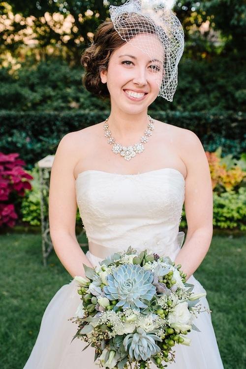 Bridal gown by Annasul Y. Bouquet by Loluma. Image by Carolina Photosmith.