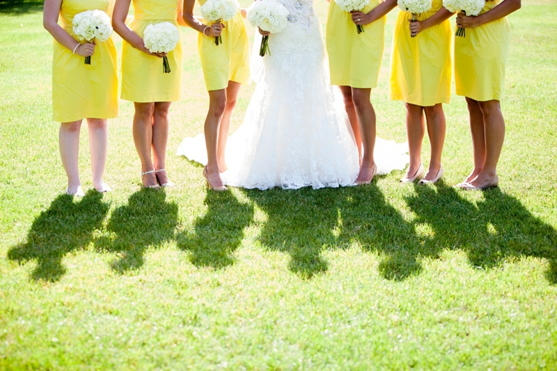 Bridal gown by Enzoani. Bridesmaid's dresses from J.Crew. Florals by Tiger Lily Wedding. Image by Hunter McRae Photography at the Creek Club at I'On.