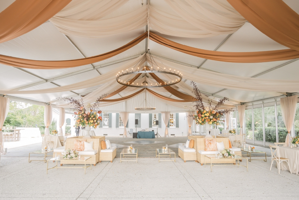 Cinnamon-hued accents and tent swags brought a seasonal touch to the reception area. The blue accents were a subtle nod to Brian's alma mater, Penn State.