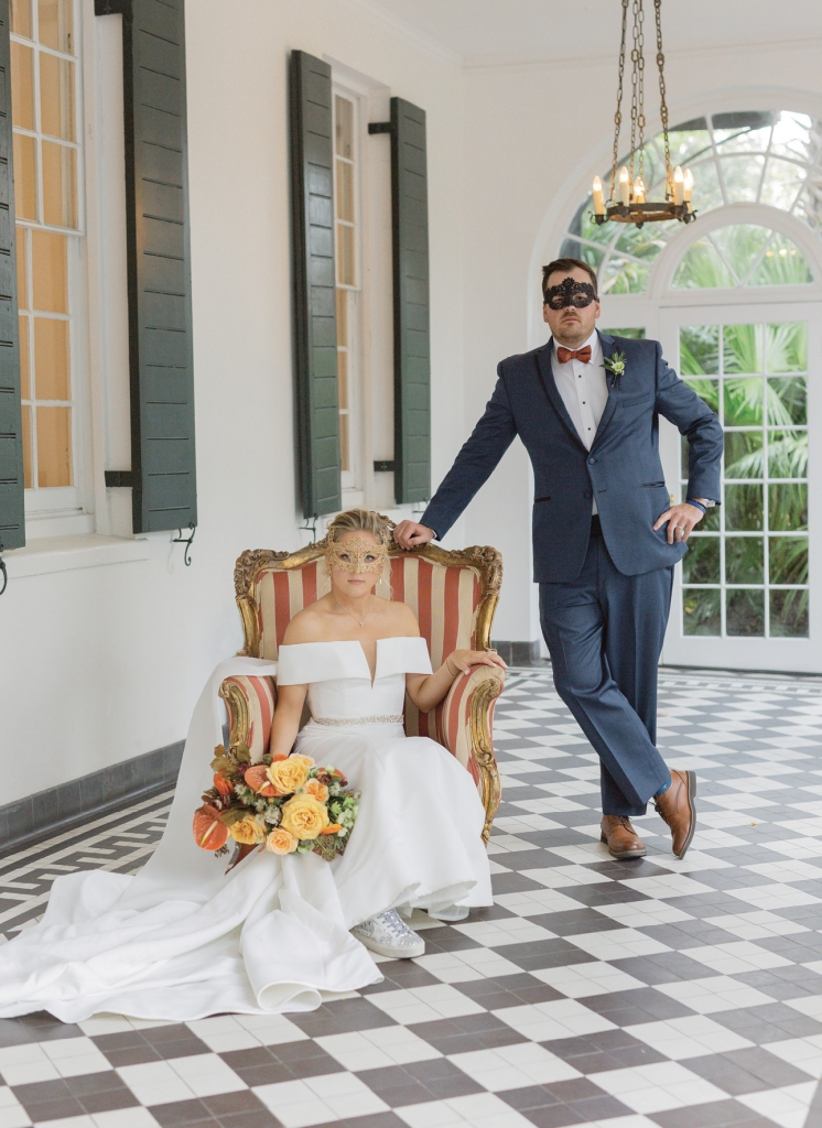 The couple wanted to acknowledge the holiday celebration associated with their wedding day without going over the top. For their couples portraits, dramatic costume ball masks were part of the photo shoot.