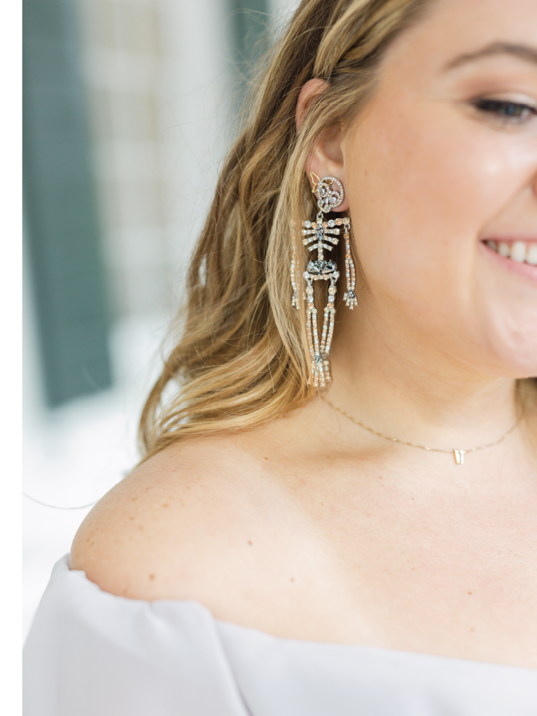 Madison supplied bridesmaids with distinctive Halloween earrings from BaubleBar to wear at the reception, lending a playful element to the festivities.