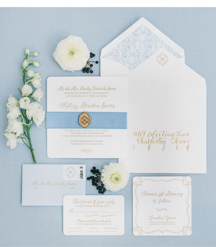 The invitation suite by Sixpence Press included envelope liners that echoed the pattern from the table linens.