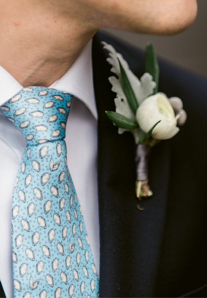 Dress the part. Ties—whether for the groom, his men, or servers—are a great place to work in thematic designs and colors. This groom and his cohorts donned silks dotted with tiny oysters.   <i>Photograph by Marni Rothschild Pictures</i>