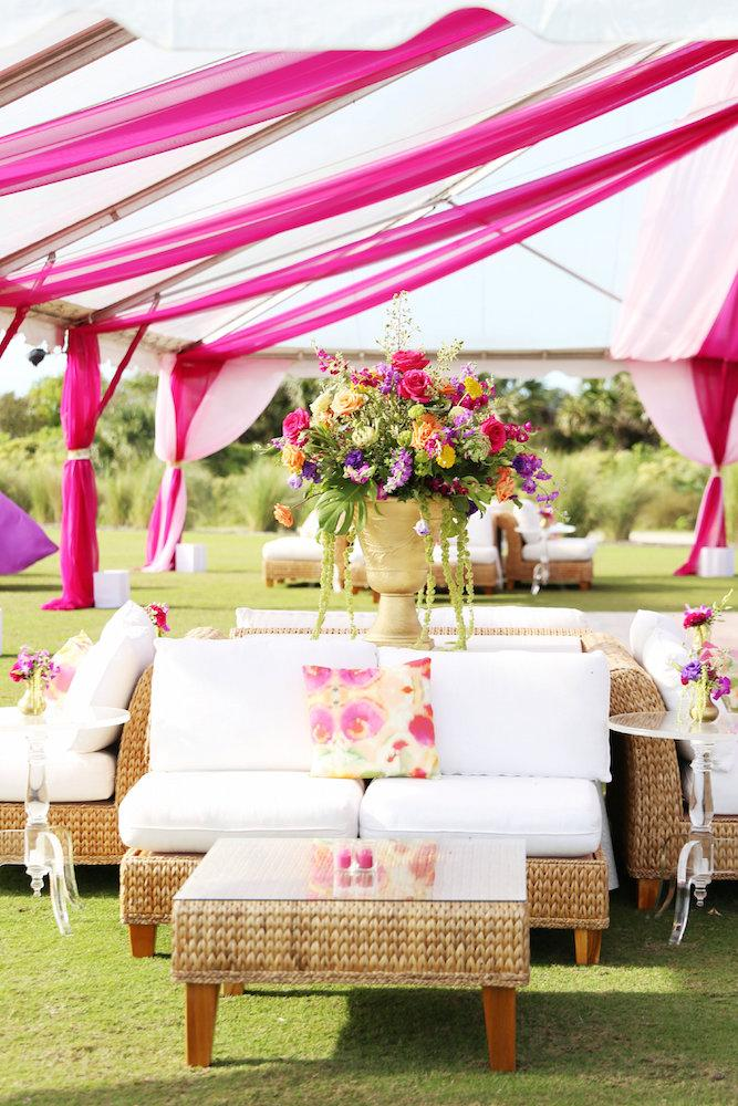 Wedding and floral design by A Charleston Bride. Furniture by EventWorks. Tent by Snyder Events. Image by Lindsay Collette Photography.