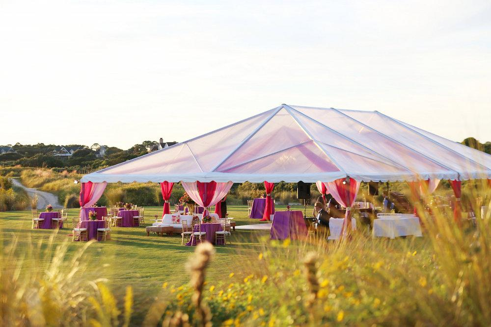 Wedding design by A Charleston Bride. Tent by Snyder Events. Image by Lindsay Collette Photography at The Ocean Course at Kiawah Island.