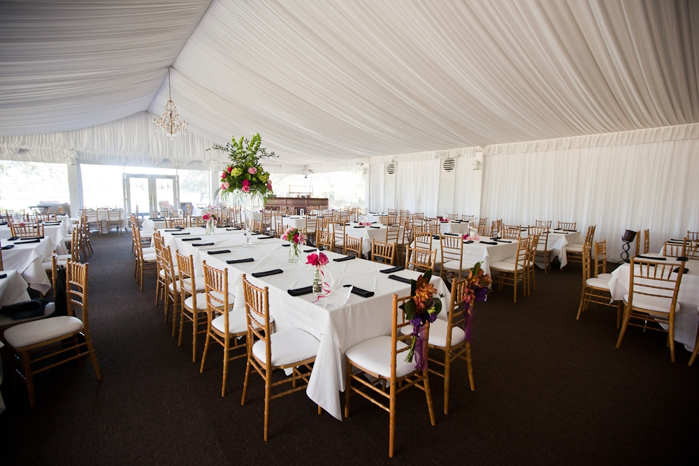 A TENTED AFFAIR: The high-topped tent, provided by the Cassique Clubhouse, allowed for a spacious reception. The draped white fabric and one clear wall balanced out the hall's dark floor.