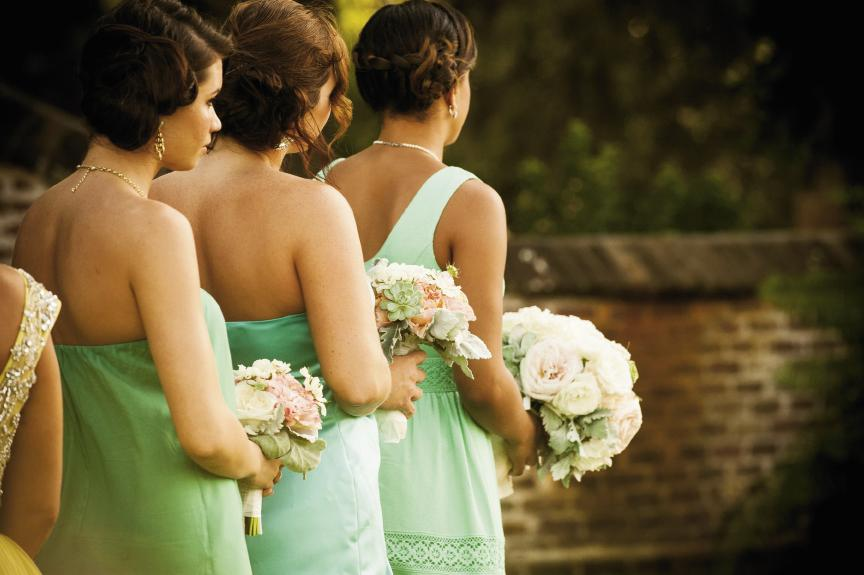 ALL IN A ROW: Amanda's bridesmaids chose dresses in varying shades of turquoise.