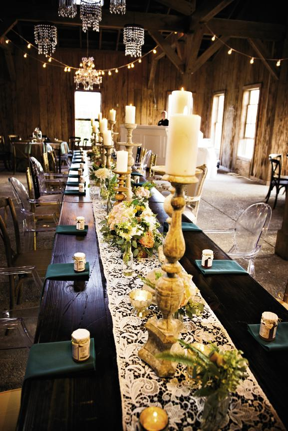 LIGHT BRIGHT: Tall pillar candles, votives, and bistro lights created an intimate glow throughout the Cotton Dock.