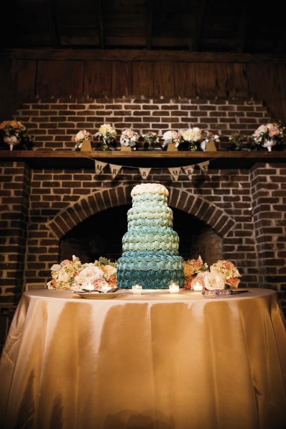 "OMBRÉ EFFECT: Tammy Kasarda of Cakes by Kasarda iced the cake in thick rosette ribbons that graduated from a rich teal to white. ""When we tried Tammy's cakes, she won our hearts,"" Amanda says."