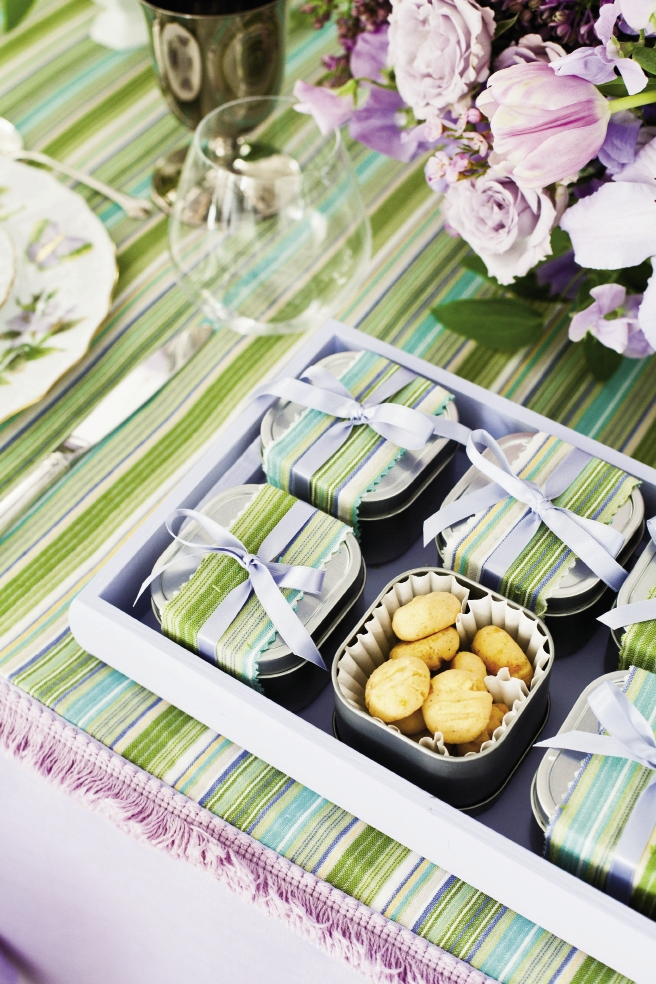 "LIGHT BITE: Small boxes of Kimberly Glenn's cheese ""straws"" were wrapped in tablecloth remnants and tied with pale lilac ribbon."