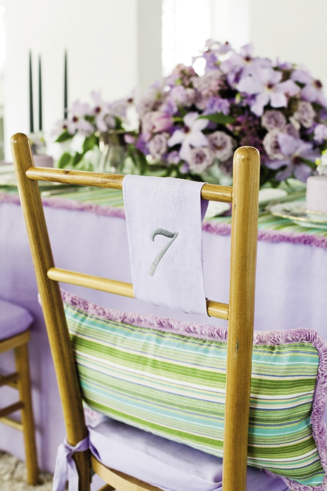 NUMBERS GAME: remnants were used for the embroidered table number, which was simply tied onto the back of a Lane chair (designed by Tara).