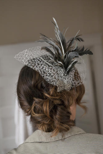 (HEAD)DRESSED TO IMPRESS: The bride's mother and sister both donned vintage fascinators.