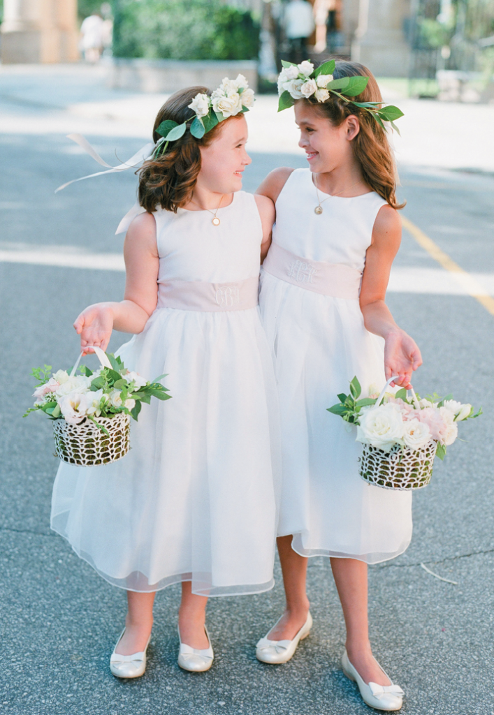 "Bosom Buddies - Flower girls Caroline and Kennedy are first cousins of bride Libby. The junior attendants' monogrammed sashes were made from extra fabric Libby ordered with the bridesmaids' gowns. ""The girls felt extra-special when they got soft curls and a touch of makeup,"" says Libby."
