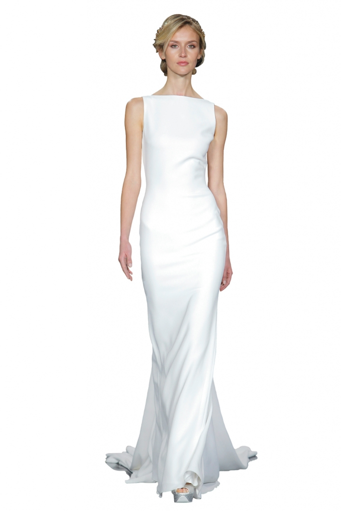 "TREND: Bateau neckline (Surprise! The back of this gown is bare with a stunner of a train.) GOWN: Pronovias' ""Nogal,"" available in Charleston through Gown Boutique of Charleston"