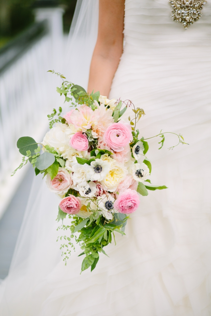 Pick meaningful florals, like the anemones in Rose's bouquet—the sapphire centers of which were a nod to her birthstone.  <i>Photograph by Riverland Studios</i>