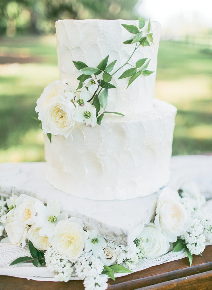 BALANCE THINGS OUT: Offset the refined look of sterling silver, crystal, and cane-back chairs with rustic touches, like this home-style iced cake.