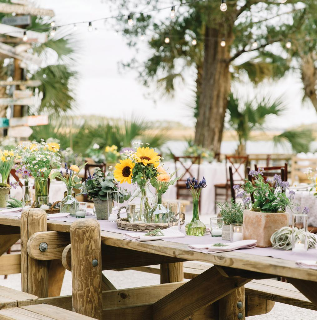 At Courtney Shea and Braden Smith's rehearsal dinner at Montage Palmetto Bluff, Jackson Durham Events crafted florals around the Kansas-born groom's home-state bloom, the sunflower. Why? The NFL offensive tackle just so happens to be an avid gardener.