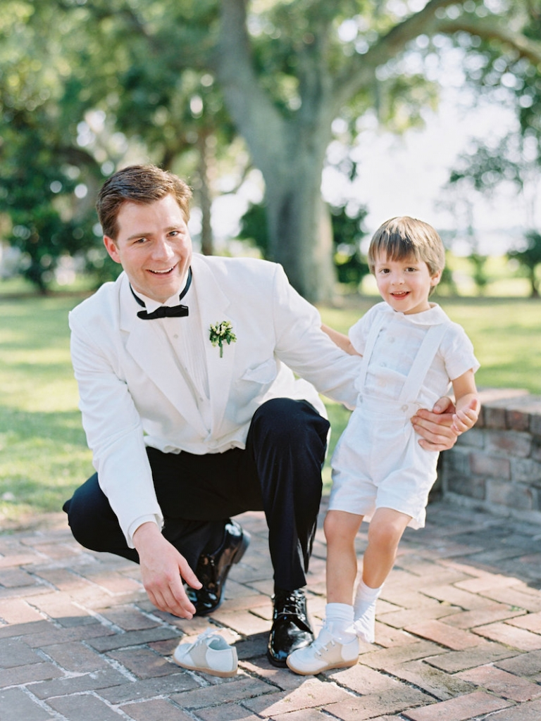 Groom's attire from Mens Wearhouse. Ring bearer's attire by Florence Eiseman. Image by Ryan Ray Photography at Lowndes Grove Plantation.