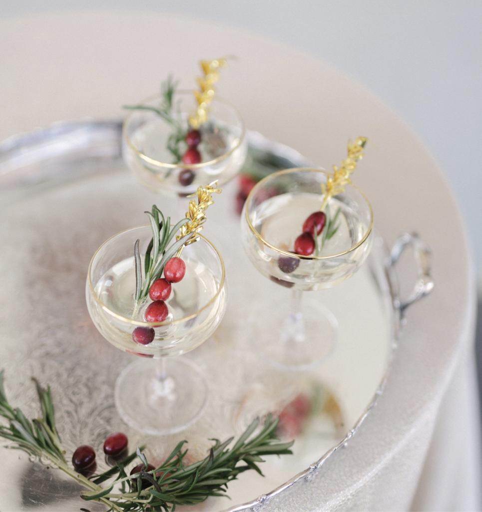 For Christmastime  nuptials, opt for natural seasonal touches, like sprigs of rosemary and cranberries for champagne garnishes.