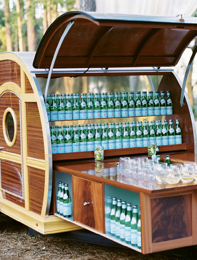 A chic bar cart was filled with sparkling water on the way in.