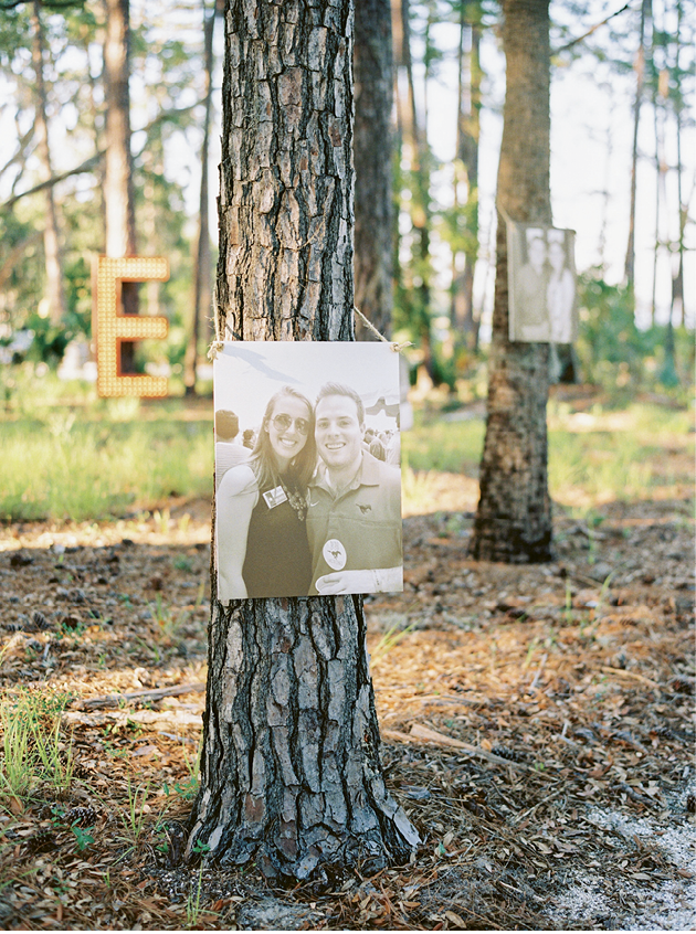 Along the walk to the landing, oversized photos of the couple hung on the trunks of pines.