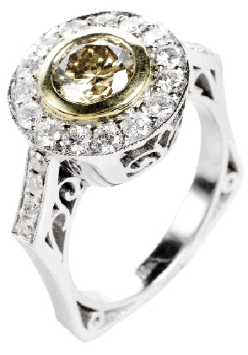 RoundAbout: 18K white and yellow gold ring with 1.13 ct. yellow-brown diamond and accent diamonds(.90 total ct.)Joint Venture, $6,200