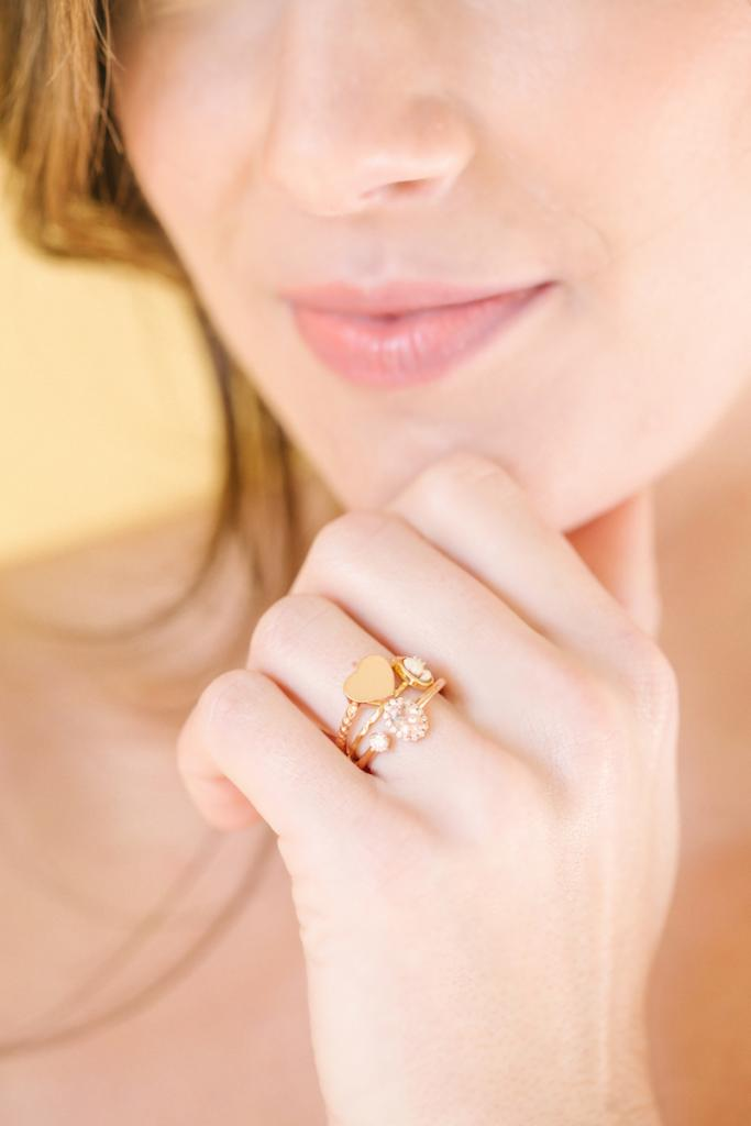 "Rose gold heart ring and morganite and diamond open ring, both from Gold Creations. Chan Luu's cameo ring from Out of Hand. Matthew Christopher's ""Felicity"" gown from Southern Protocol Bridal."