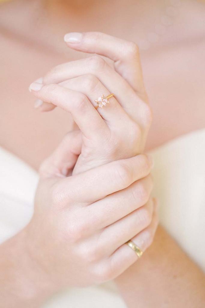 "Mizuki's pearl choker from Croghan's Jewel Box. David Yurman's ""Chatelain"" ring from REEDS Jewelers. Engraved gold band from Croghan's Jewel Box"