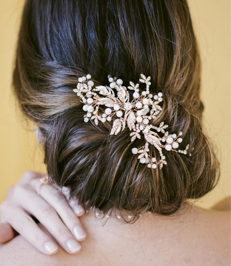 """Bel Aire Bridal's comb from Verità. A Bridal Boutique. Mizuki's pearl choker from Croghan's Jewel Box. David Yurman's """"Chatelain"""" ring from REEDS Jewelers."""